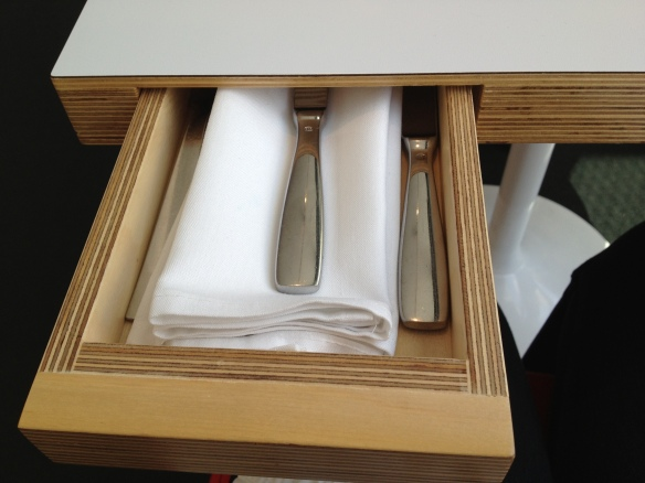 At Ray's Restaurant at the LA County Museum of Art, the tables have little drawers. Inside them you'll find your napkin, fork and knife. Loved it!