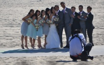 While taking photos around the beach in Santa Monica, I came across this unexpected scene and couldn't resist a shot at being a wedding photographer. Not sure this was nice, but they looked so good!
