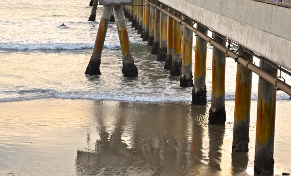 While photographing the Venice Beach Pier reflection on the wet sand, I caught a lone surfer on the background.