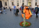 These men dressed in orange are everywhere in Rome, Italy.