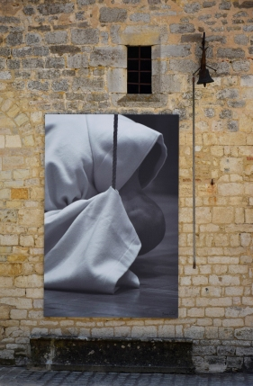 The giant photograph of a monk reminds us of the origins of Clos de Vougeot.