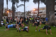 Made this group of exercise boot campers look like they were kicking each other's behinds...