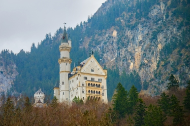 Schloss Neuschwanstein (New Swanstone Castle) from the bottom of the hill. The castle was commissioned by Ludwig II as a retreat and as a homage to composer Richard Wagner. The castle is also famous for being the model for Disneyland's Sleeping Beauty Castle.