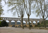 The Pont du Gard is an ancient Roman aqueduct that crosses the Gardon River near the town of Vers-Pont-du-Gard in southern France.